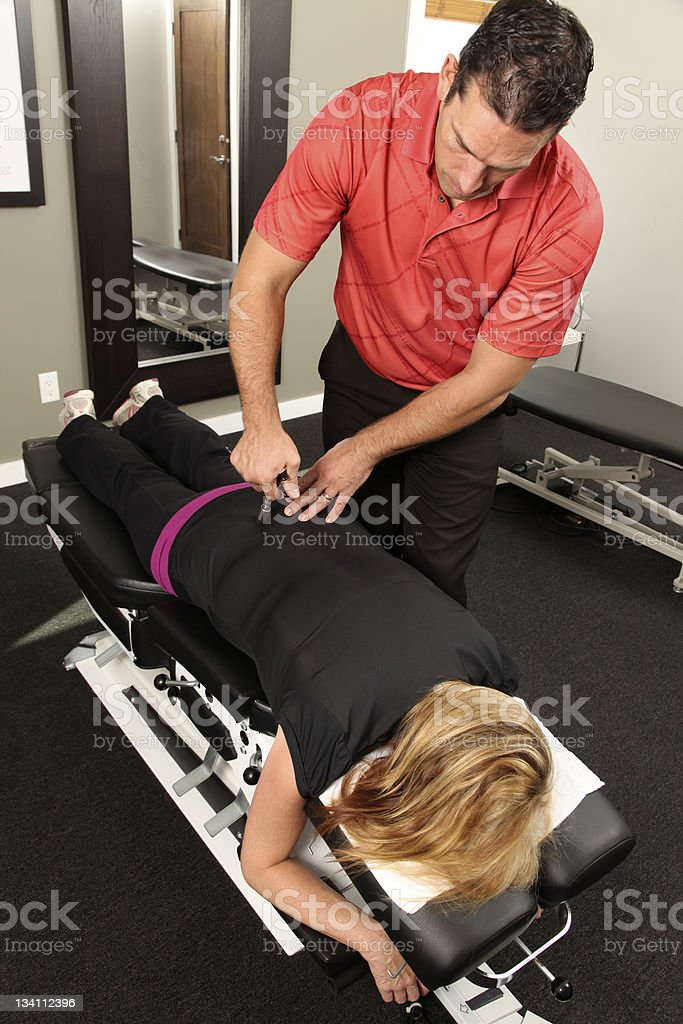 A chiropractor treating his patient royalty-free stock photo