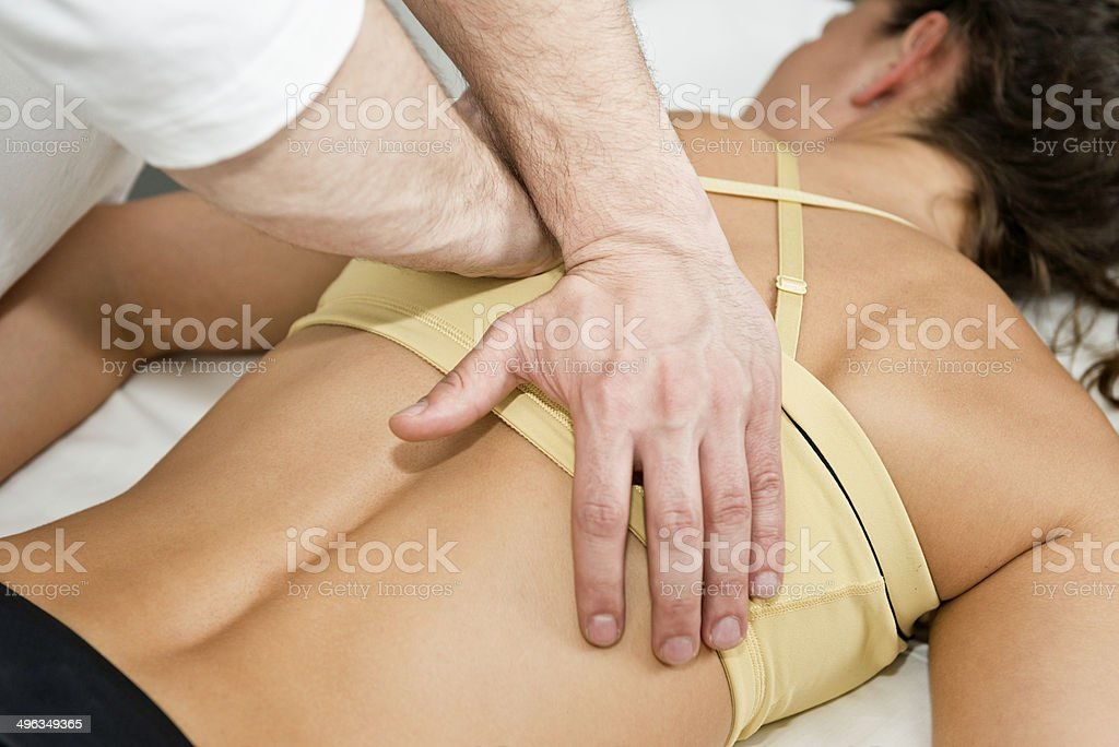 Chiropractor treating patient stock photo