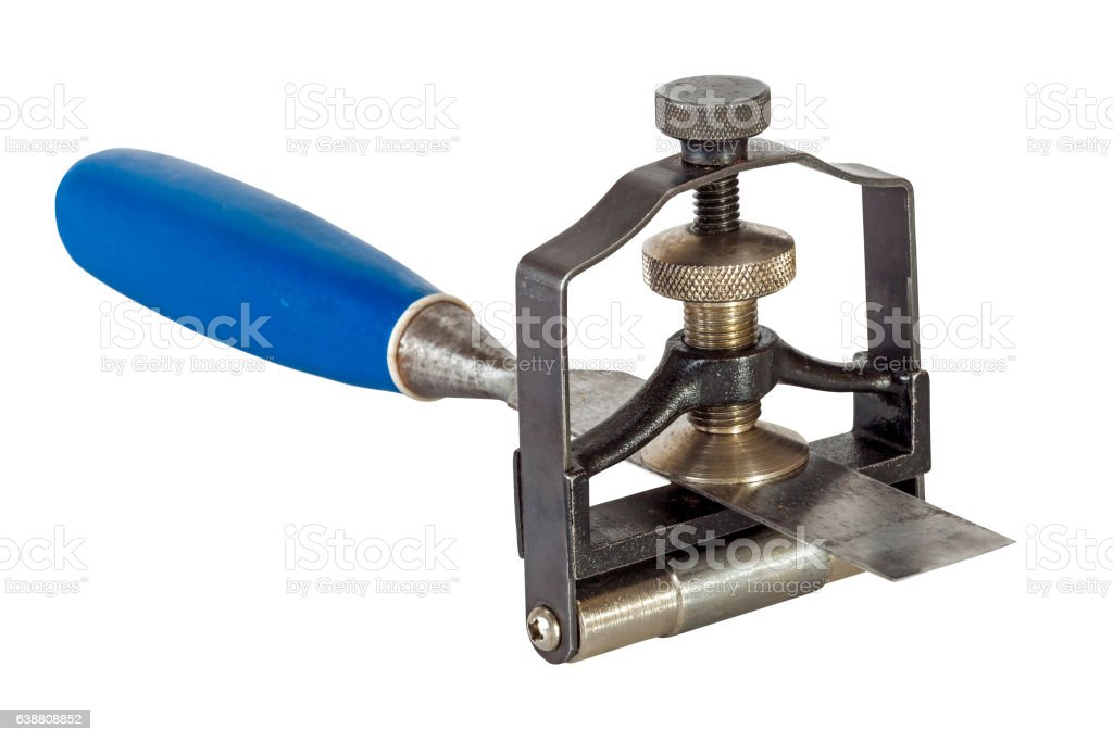 Chisel Clamped in Angle Guide Jig on White Background stock photo