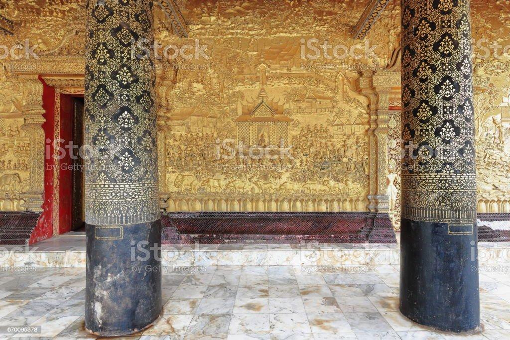 Chiseled ang gilded wall-Wat Mai Suwannaphumaham-New Monastery. Luang Prabang-Laos. 4037 stock photo