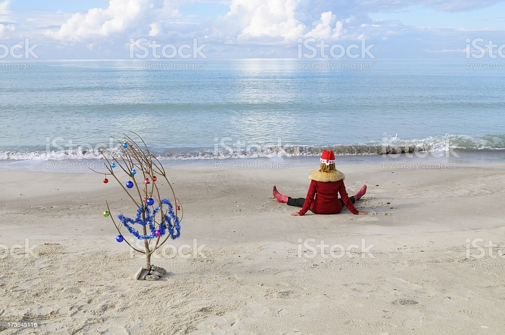 Chistmas Tree and Santa Claus on the Beach royalty-free stock photo