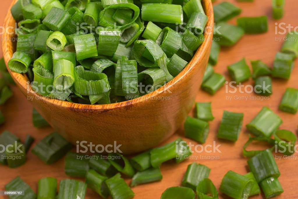 Chive. Sping Onions into a bowl stock photo