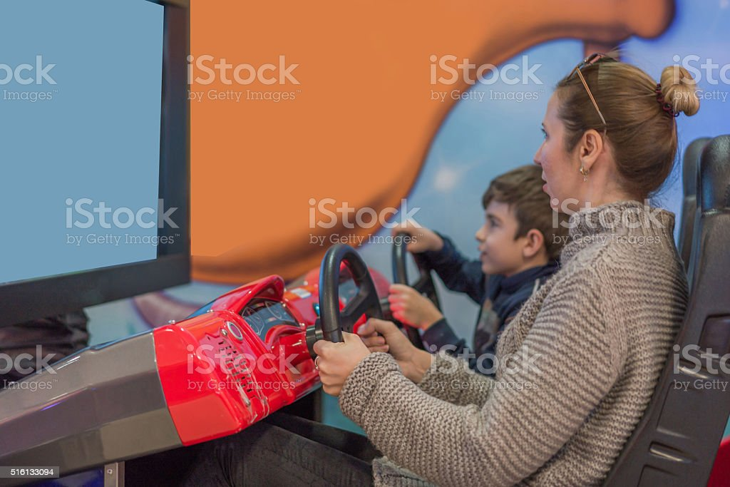 chıld play video game with mother stock photo