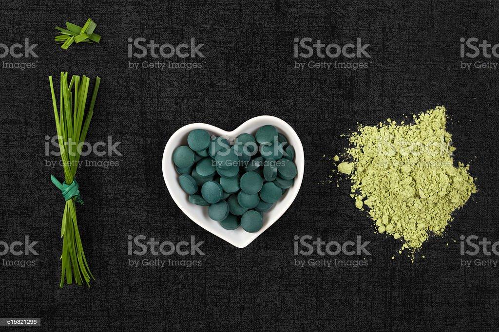 Chlorella, spirulina and wheatgrass. stock photo