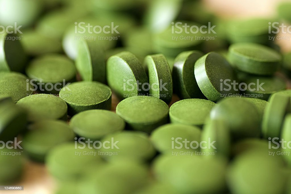 Chlorella tablets royalty-free stock photo