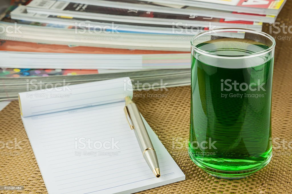 chlorophyll  in glass and notebook stock photo