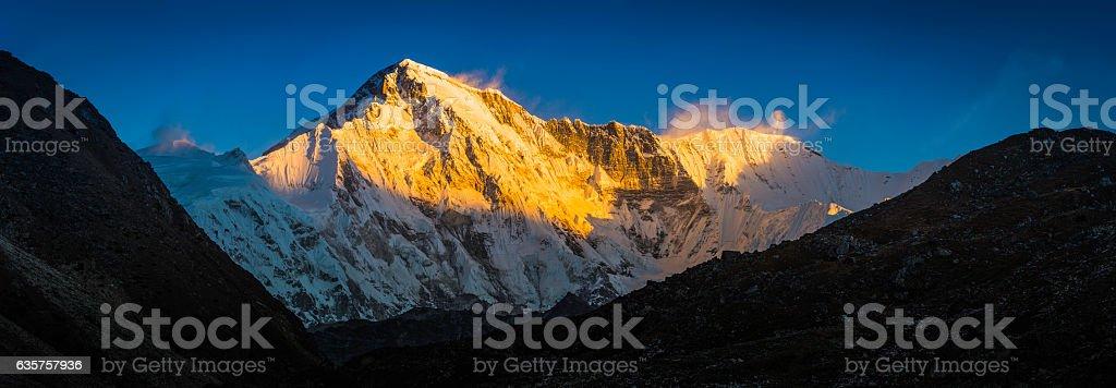Cho Oyu 8201m Himalaya mountain peak illuminated by golden light stock photo