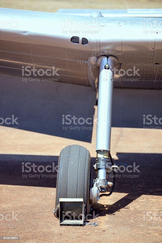 Chocked wheel on old plane stock photo