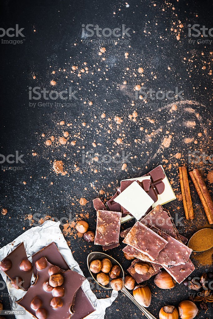 Chocolat and spices on black table stock photo