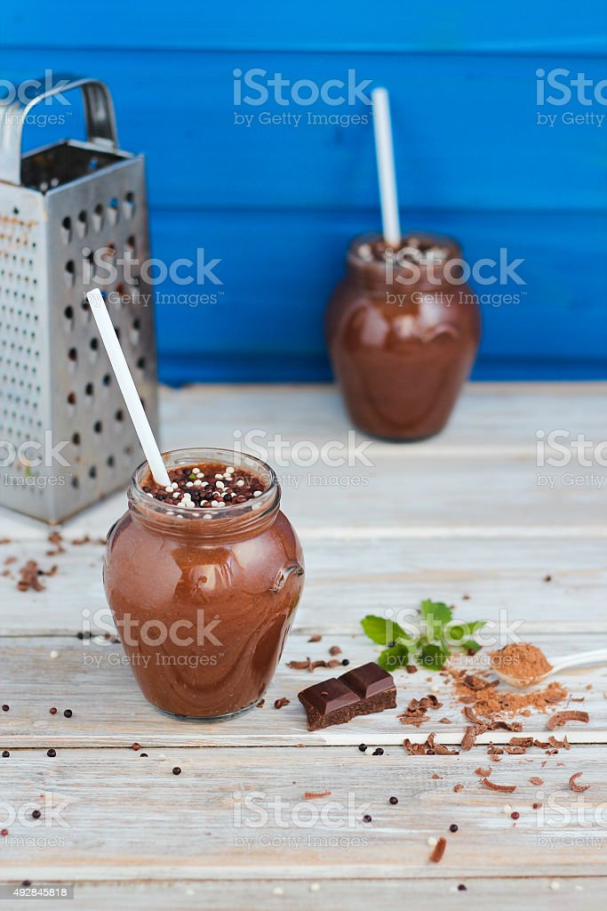 chocolate and banana smoothie with chocolate balls in jars royalty-free stock photo
