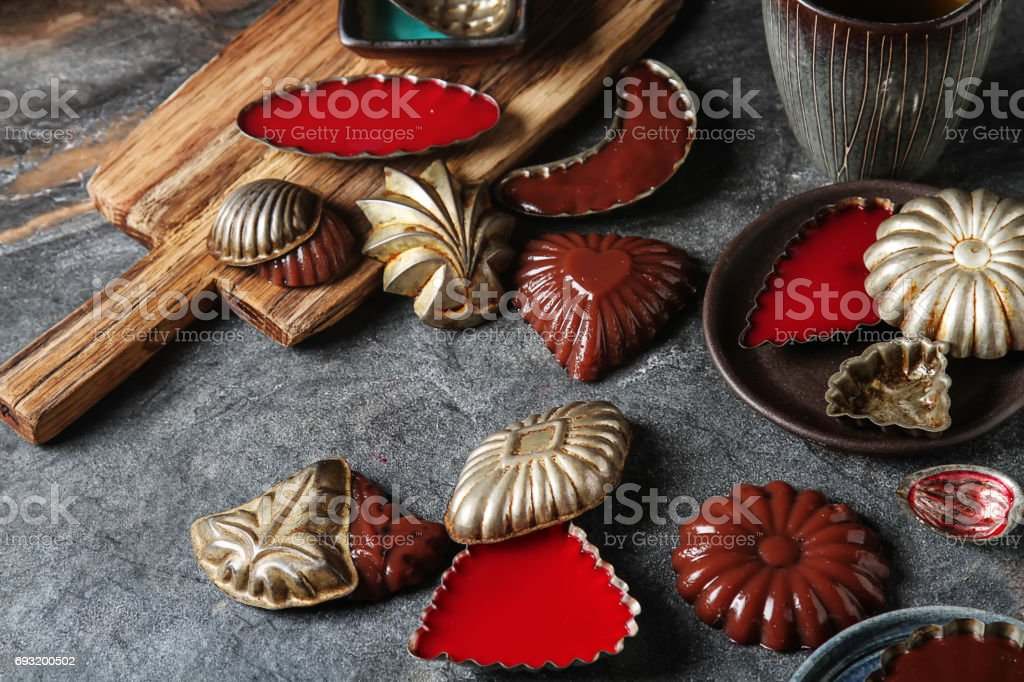 Chocolate and berry pudding in metal molds. Dark background. stock photo
