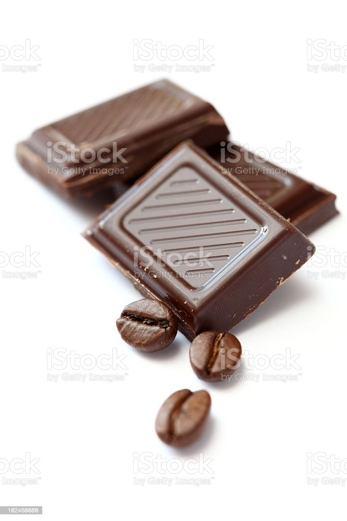 Chocolate and coffee beans on a white background royalty-free stock photo