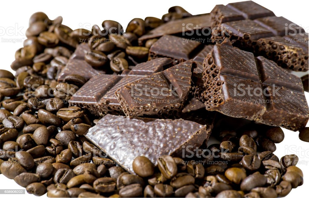 Chocolate and coffee beans on a white plate isolated background stock photo