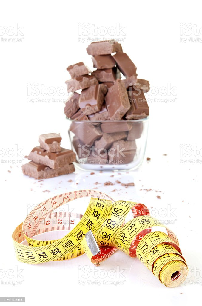 Chocolate and measuring tape. royalty-free stock photo