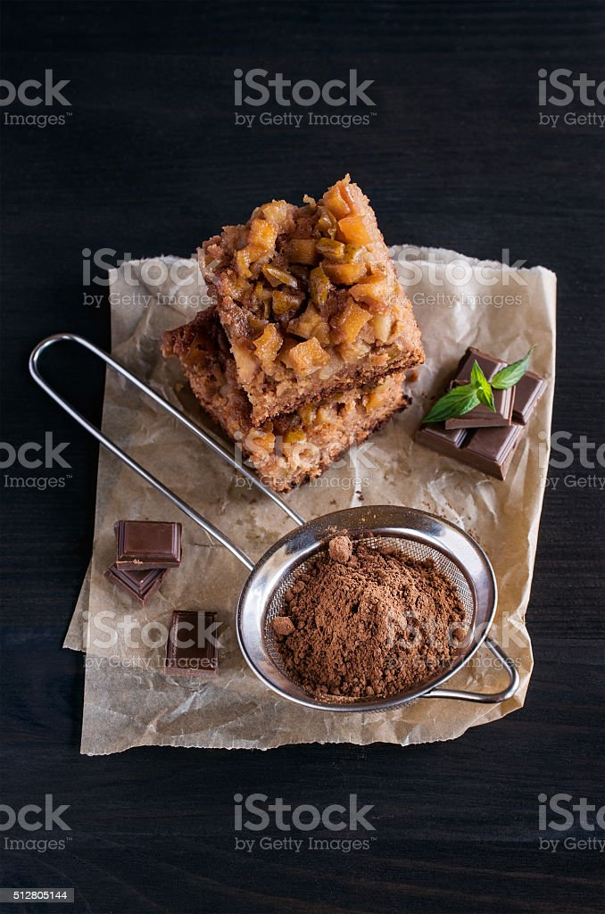 chocolate and quince tart with cocoa powder stock photo