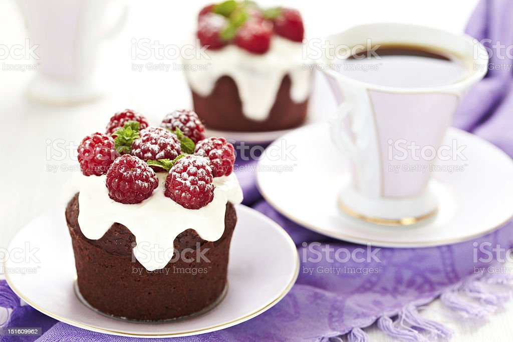 Chocolate and raspberry cupcakes royalty-free stock photo