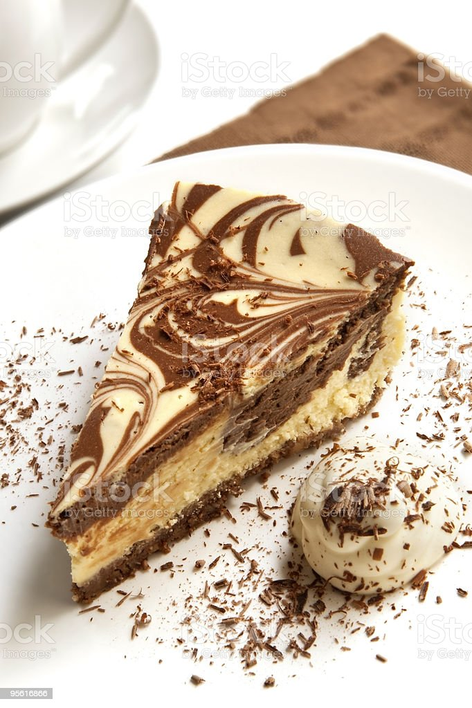 Chocolate and vanilla cheesecake on a white plate royalty-free stock photo