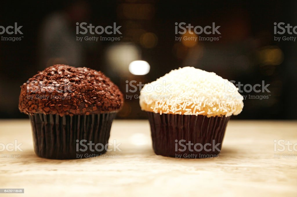Chocolate and Vanilla Cupcakes stock photo