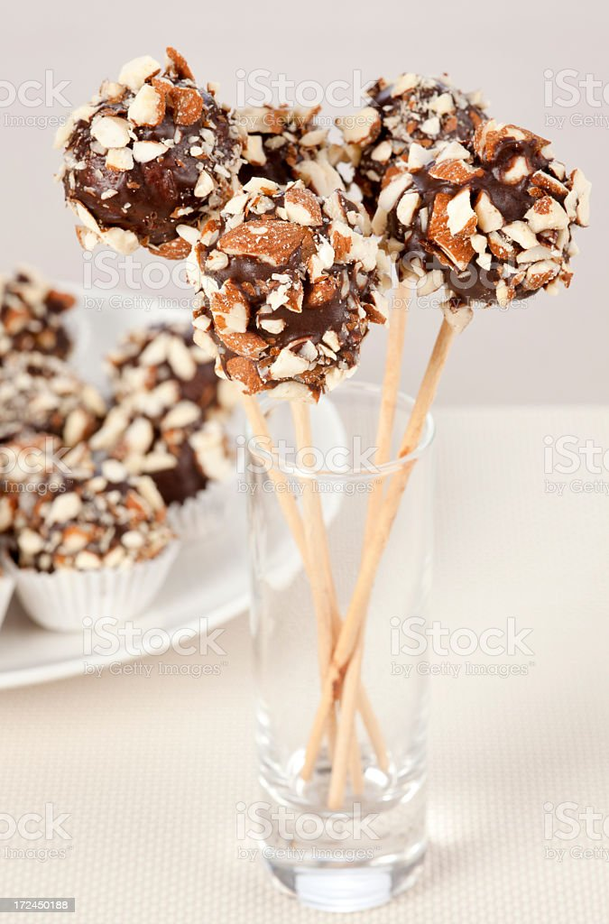 Chocolate balls are setting on sticks royalty-free stock photo