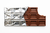 Chocolate bar with a missing bite on white background