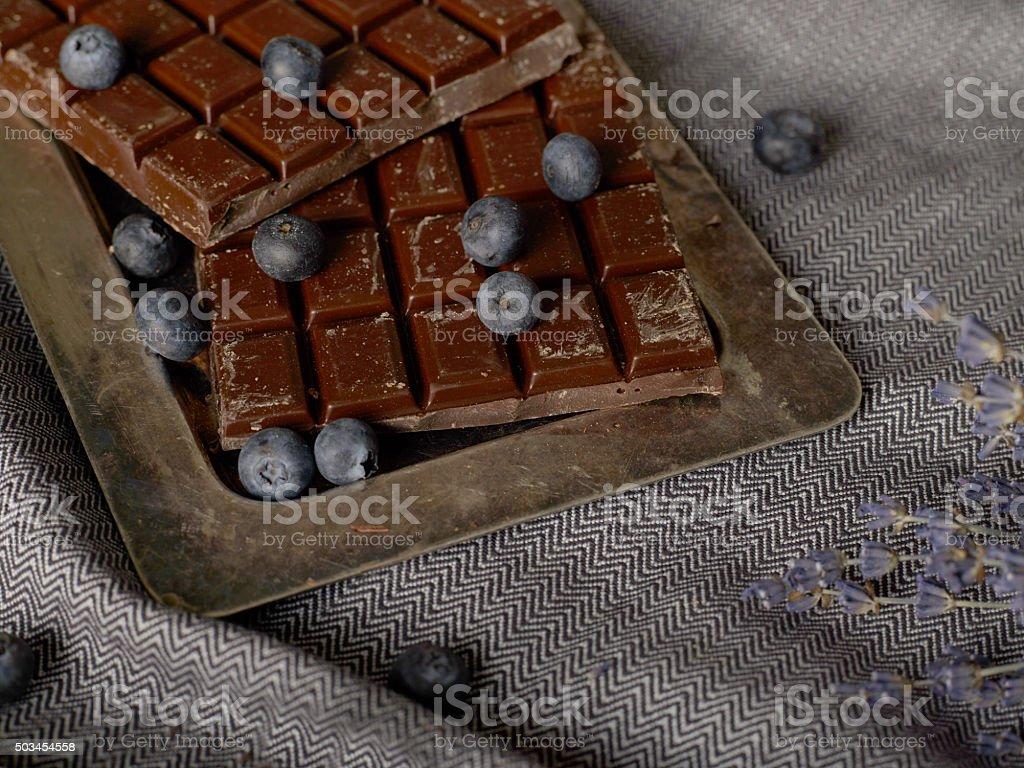 Chocolate bars and blueberries stock photo