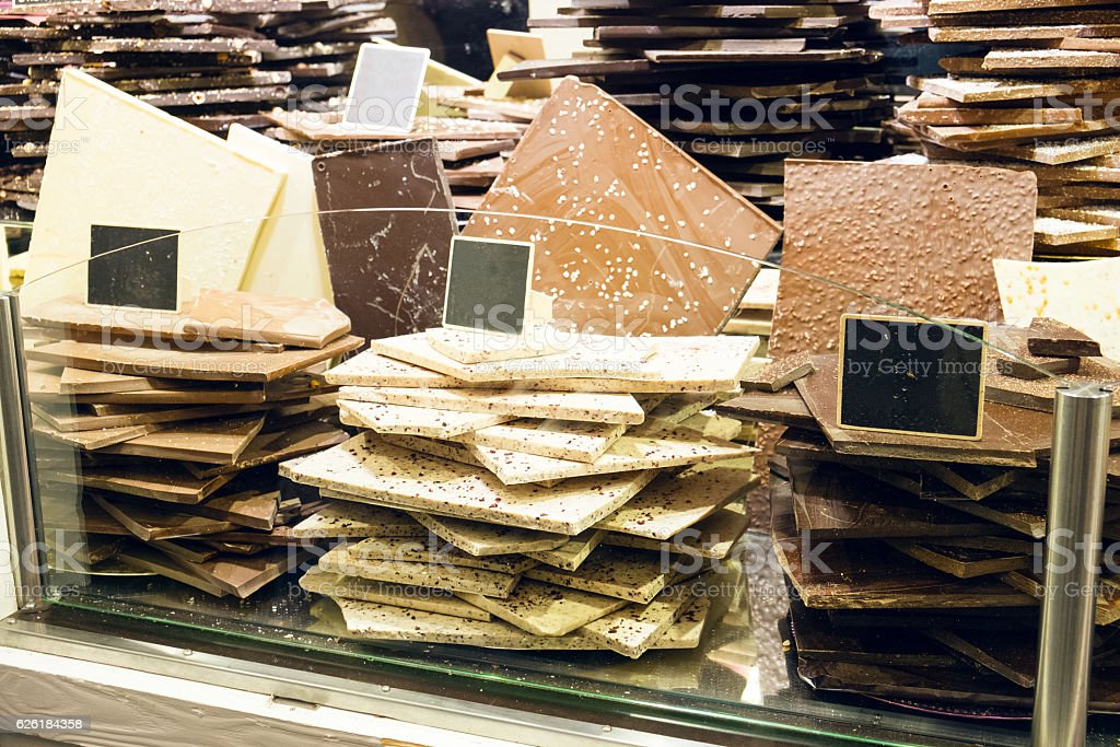 Chocolate bars stacked in store stock photo