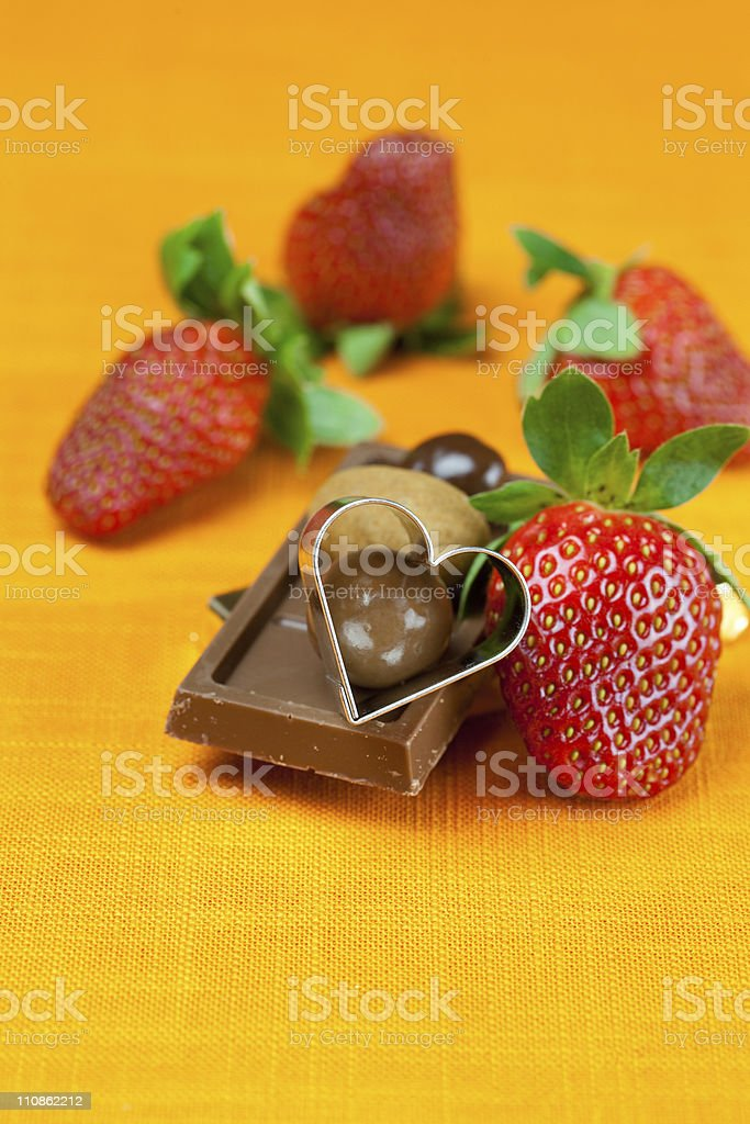chocolate bars, strawberry, heart and the candy stock photo