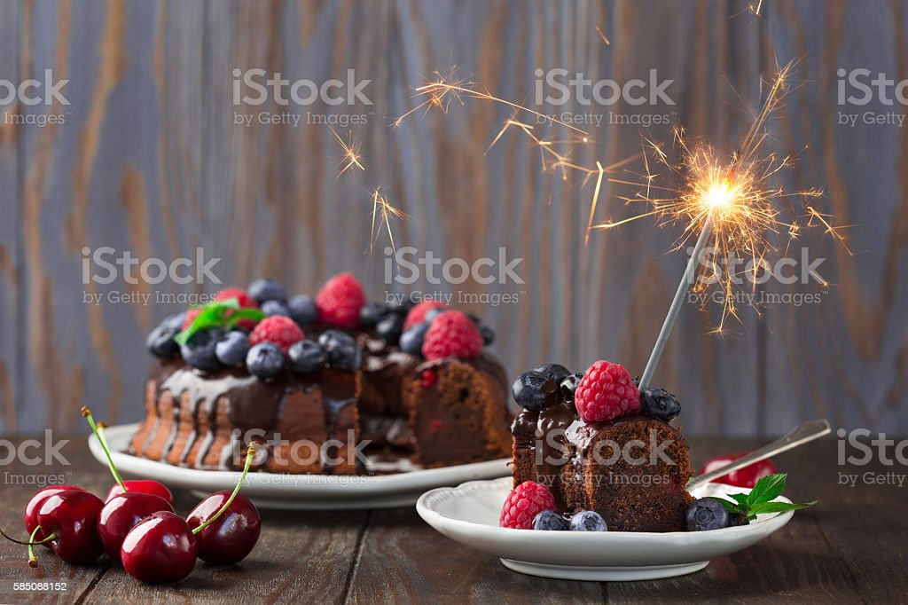Chocolate berry cake with a sparkler stock photo
