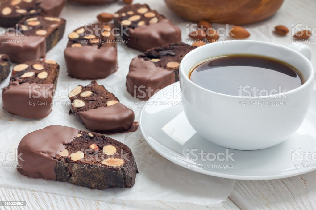 Chocolate biscotti cookies with almonds, covered with chocolate, and coffee stock photo