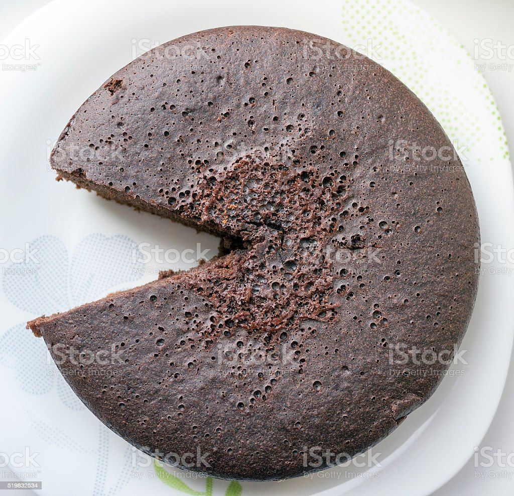 Chocolate biscuit cake, one piece cutted out. stock photo
