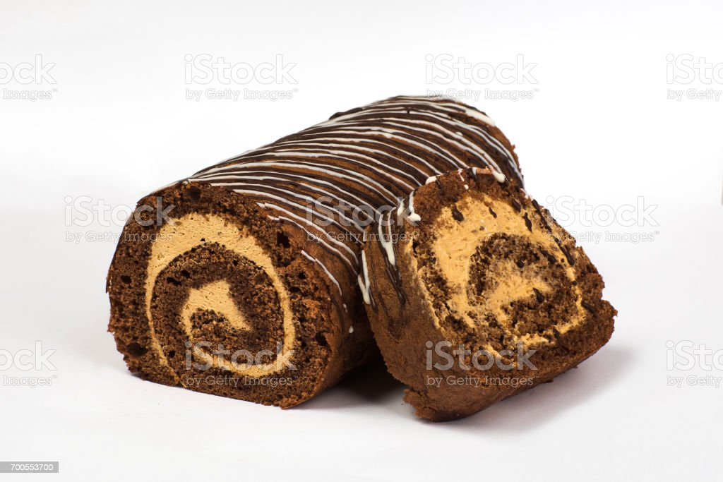 Chocolate biscuit roll with cream with chocolate stock photo