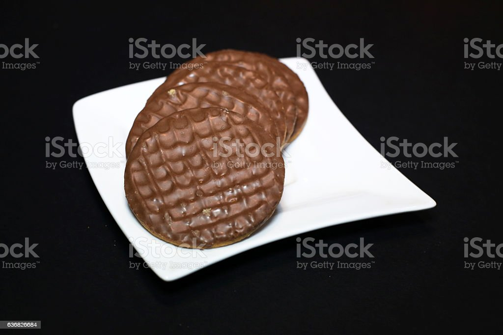 Chocolate biscuits on a white plate stock photo