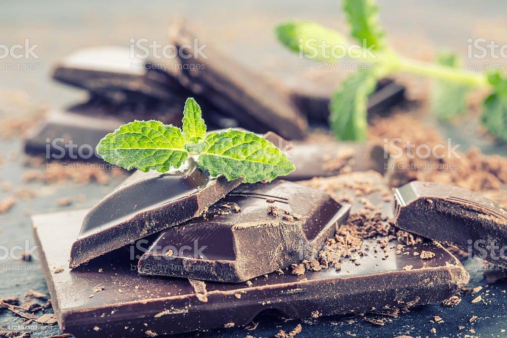 Chocolate. Black chocolate. A few cubes of black chocolate stock photo