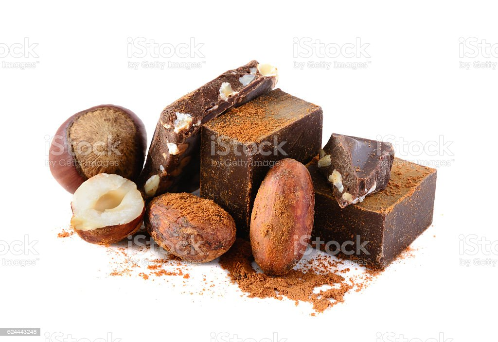 Chocolate blocks with cocoa beans and nuts isolated on white stock photo