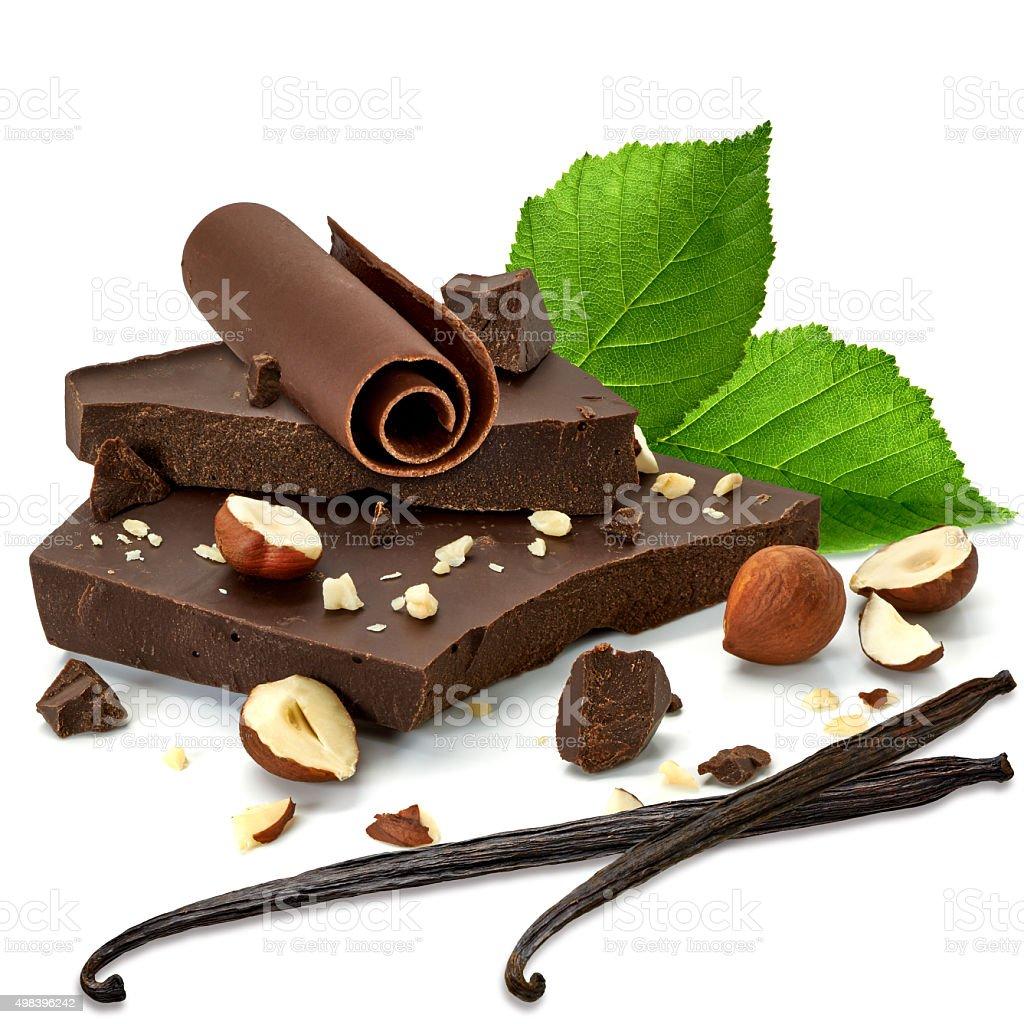 Chocolate blocks with hazelnuts and curls stock photo