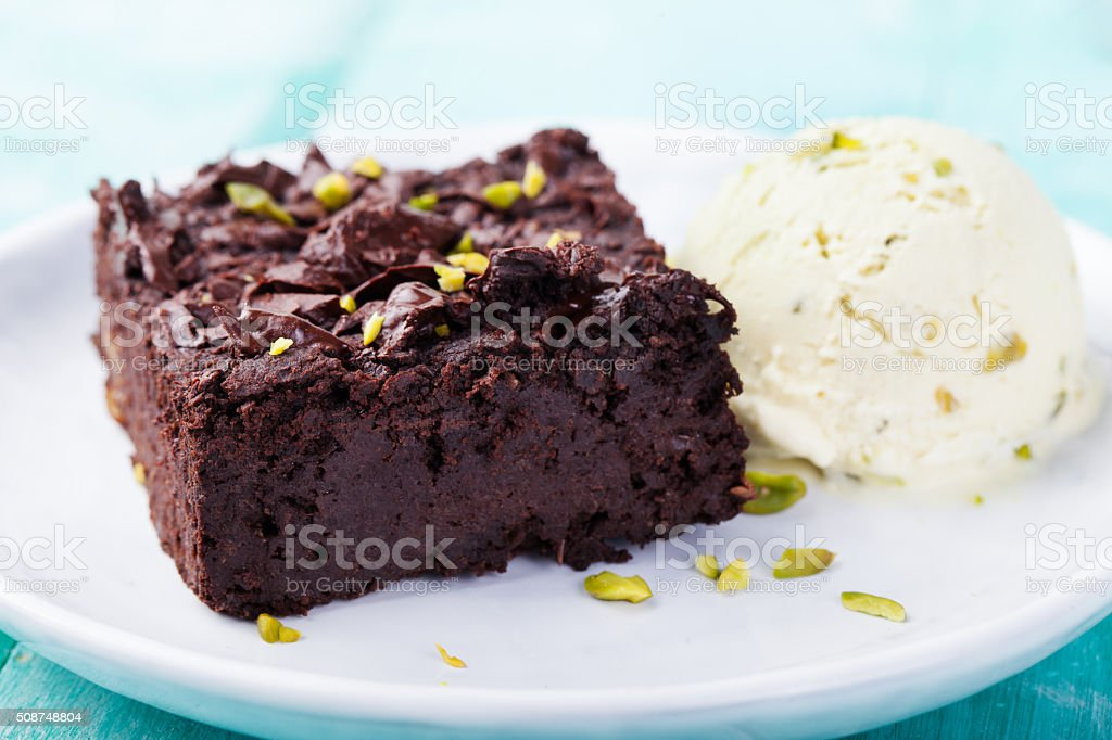 Chocolate brownie, cake on a white plate stock photo