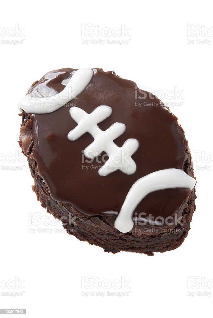 chocolate brownie shaped and decorated like a football isolated white stock photo
