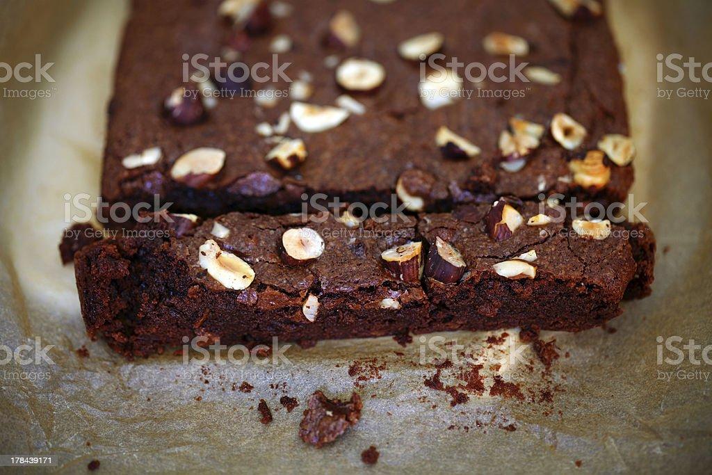 Chocolate brownie with hazelnuts, sliced, detail stock photo