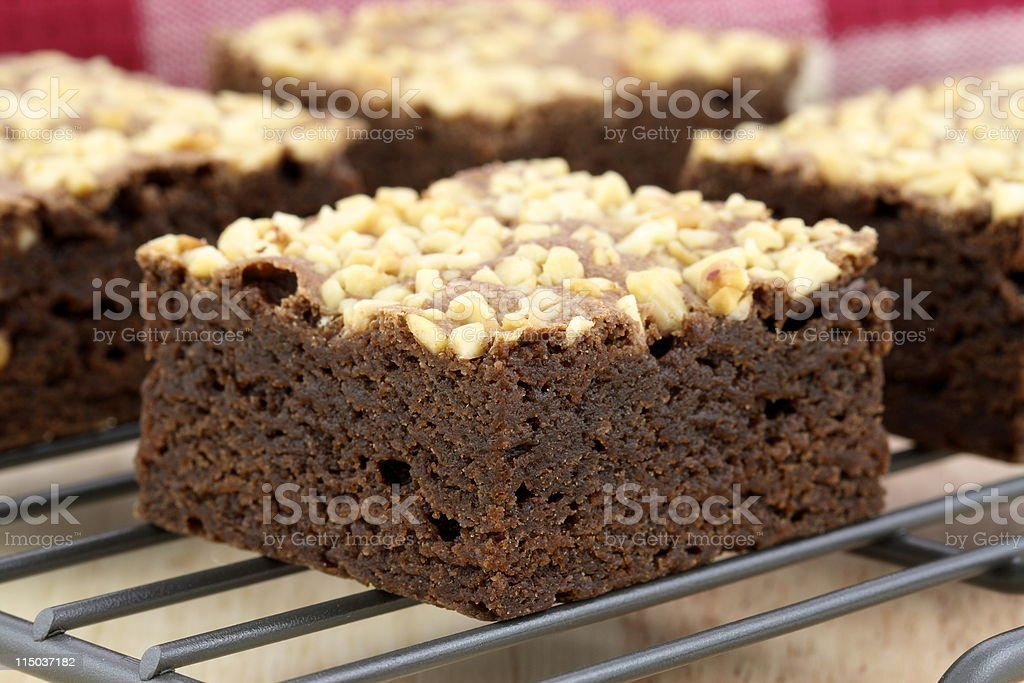 chocolate brownies with cracked peanuts on top royalty-free stock photo
