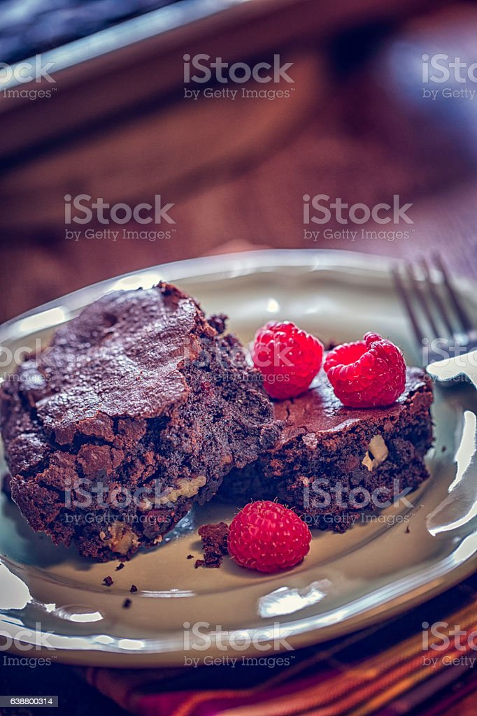 Chocolate Brownies with Raspberries Served on a Plate stock photo
