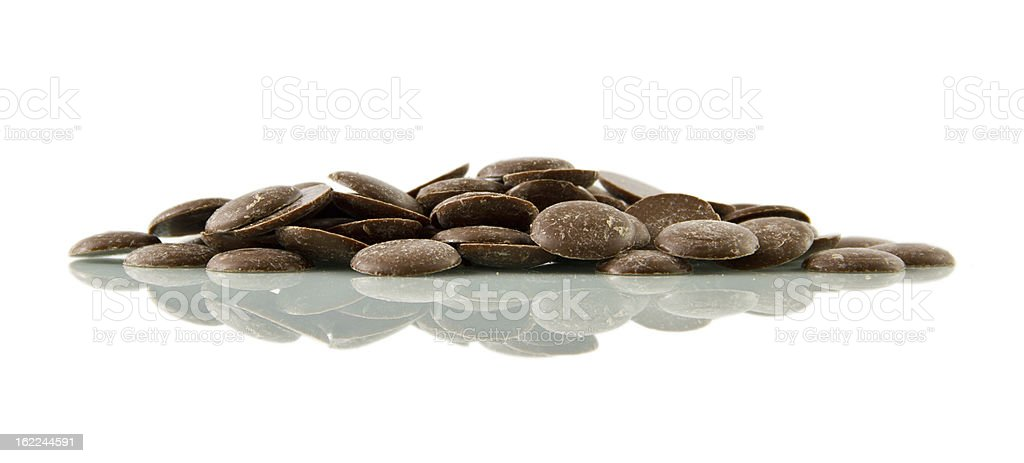 Chocolate buttons, reflected royalty-free stock photo