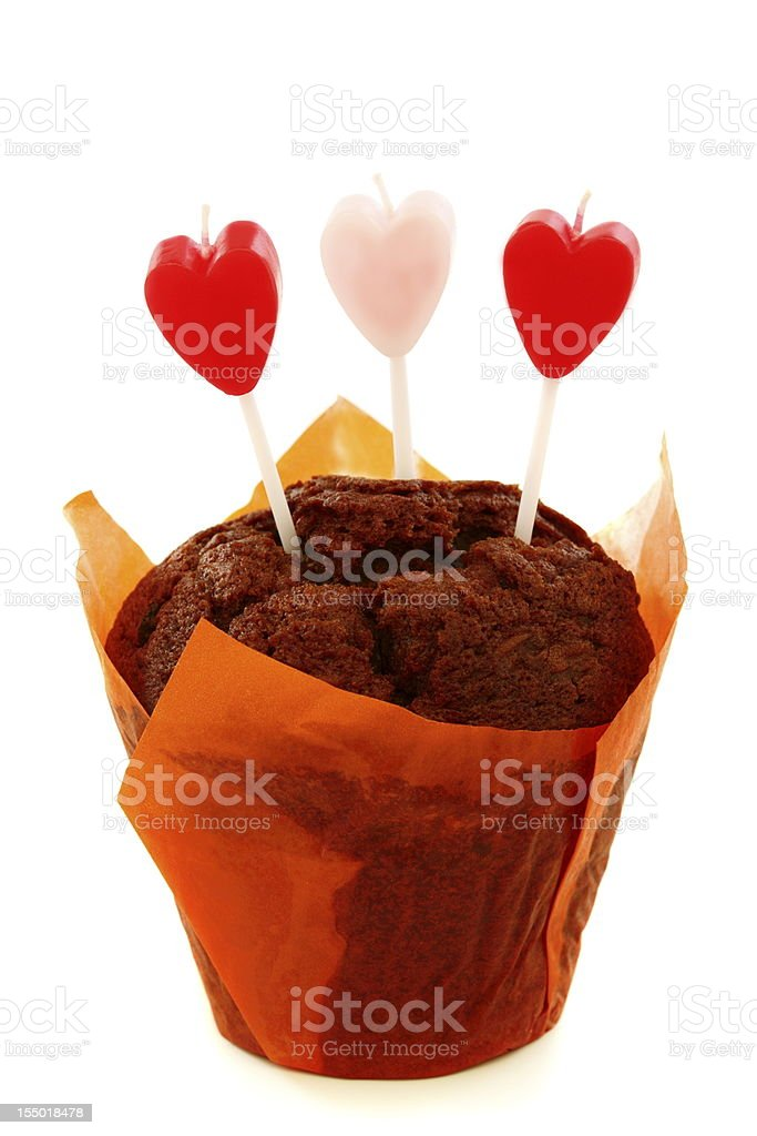 Chocolate cake and candles in the shape of heart. royalty-free stock photo