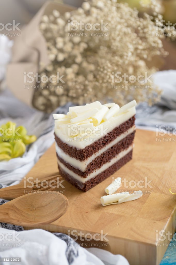 chocolate cake and white chocolate on Wood plate. cake background concept stock photo