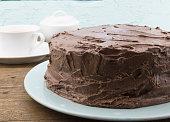 Chocolate cake close up on blue plate