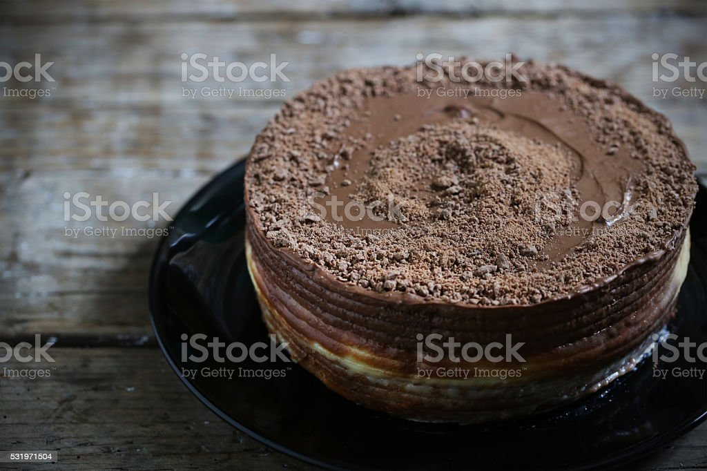 Chocolate cake filled with creamy filling, rich pastry stock photo