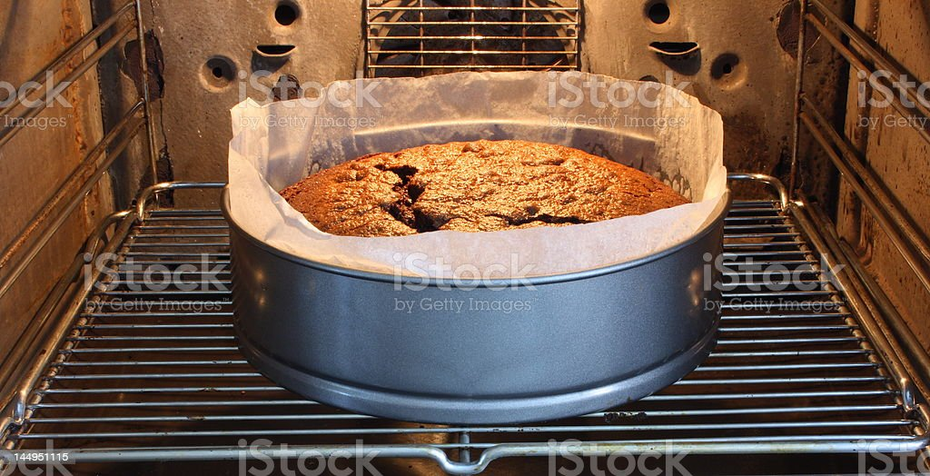 Chocolate cake in the oven royalty-free stock photo
