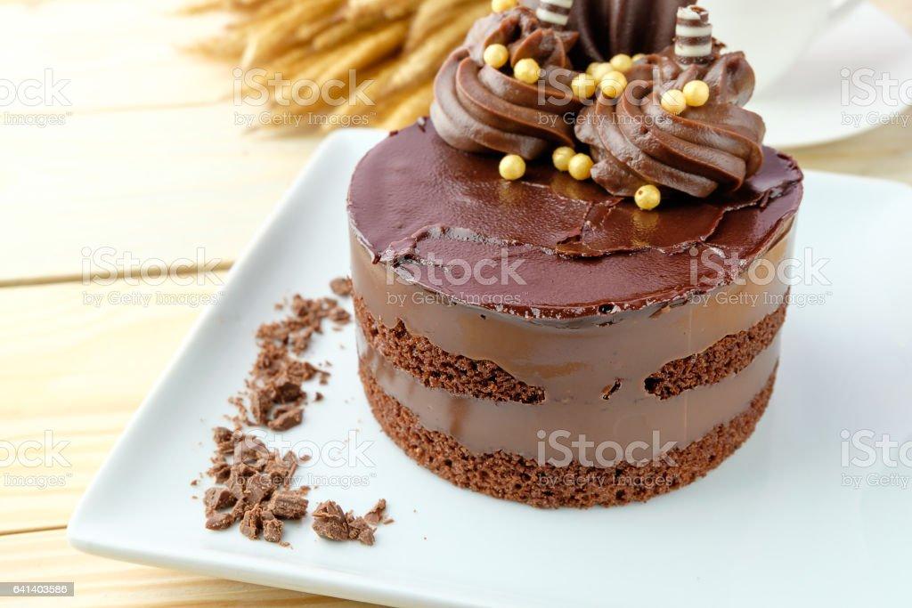 chocolate cake on wooden background stock photo