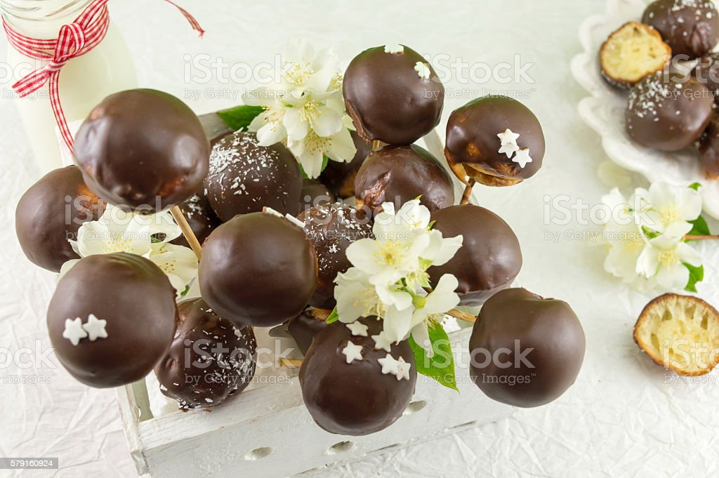 Chocolate cake pops in a wooden box stock photo