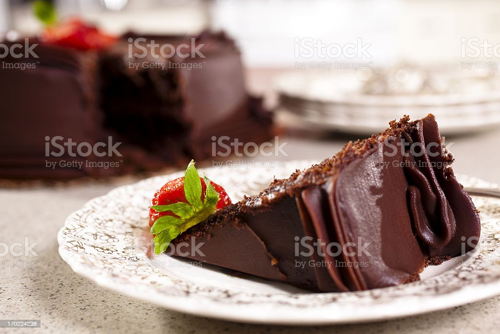 Chocolate Cake slice with Strawberries in domestic kitchen stock photo