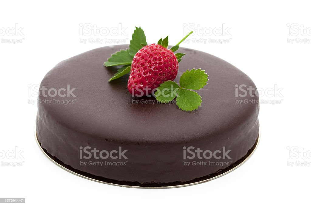 Chocolate cake topped with a strawberry stock photo